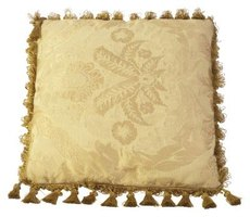 Pillows in tonal brocade have remained staples in home decor for many years.