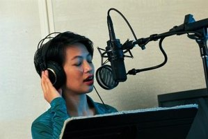 Voice actors record their lines in special studios.