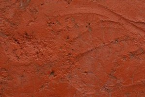 Use a stucco plaster finish to hide the imperfections in your first plaster coat.