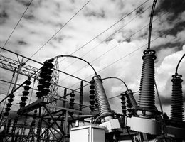 Houses receive elelctricity from power lines that transfer electricity from power plants.