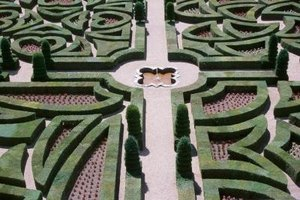Using landscape is one way to make a walk through maze.