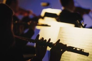 Flautists can play in wind ensembles or in larger groups such as symphony orchestras.