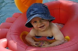 A pool party is a simple idea for a baby's first birthday.