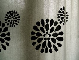Embellish plain curtains with a painted design.