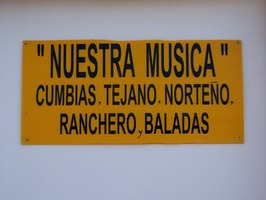 A sign in Spanish