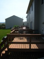 Seating can be incorporated to deck railing to flesh out a deck space.