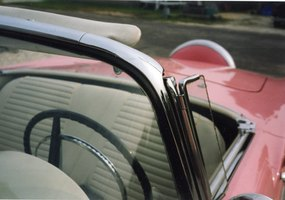 Cruise in vintage style with a pink Thunderbird convertible.