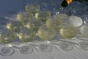 Create a champagne pyramid with champagne glasses.