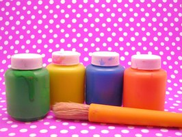 Build a mountain using basic craft supplies such as acrylic paints.