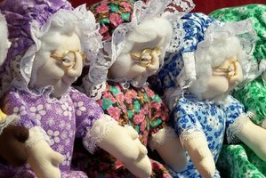 Soft sculpture style granny dolls with their arms outstretched.