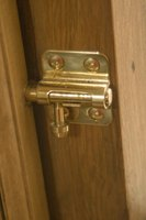 A simple catch provides more security than a door handle lock.