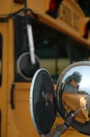 Use your mirrors in parallel parking a school bus.