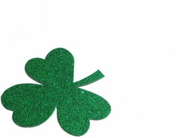 Adding glitter to a simple construction paper shamrock really glams it up.