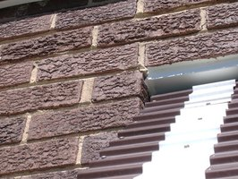 Textured paint is good at covering the uneven surface of an exterior brick wall.