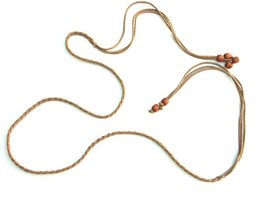 A braided leather lanyard can be embellished with beads.