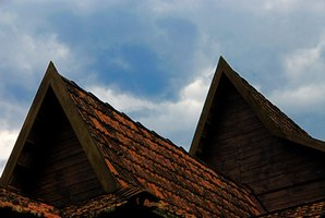 Curled roof shingles require evaluation, repair or replacement.