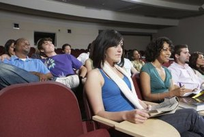 Students taking notes in lecture hall.