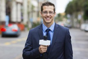 Newscaster holding a microphone reporting from the street.
