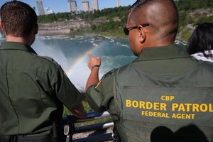 Two border patrol agents keep watch.