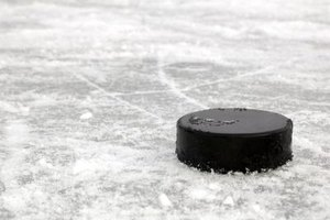 Close-up of hockey puck on the ice.