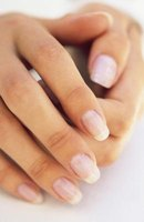 A clear top coat of nail polish can make your fingernails glossy.