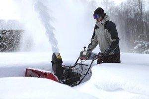 Man using a snow blower