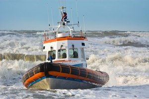 A Coast Guard boat navigates choppy water.
