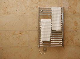 A towel rack mounted on a tiled wall