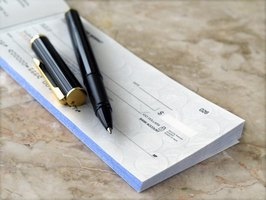 Pen on a checkbook