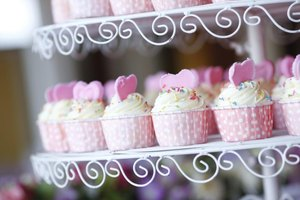 Decorate cupcakes with hearts for a romantic shower.
