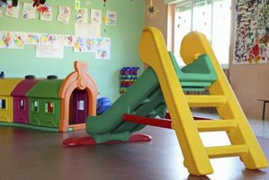 Interior of a day care centre with a slide.