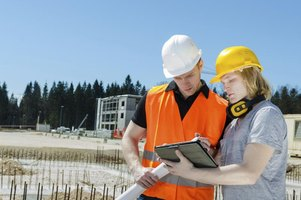 Utility locator looking at construction plans