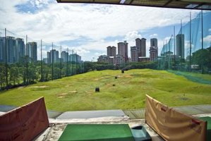 Before hitting one of Singapore's public golf courses, hone your swing on a practice range.