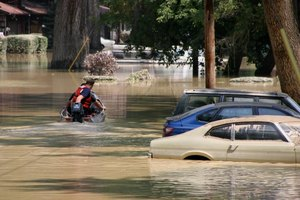 Vision of a flood wrecking homes and cars