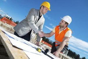 Sustainability coordinator shaking hands with construction worker on site