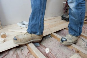 A contractor wearing steel toe shoes at a construction site.