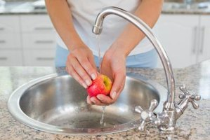 Rinsing with water may not remove all residues from an apple.