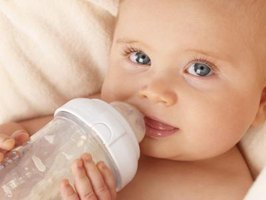 Bottle-feeding while lying down increases the risk of milk getting into the ear.