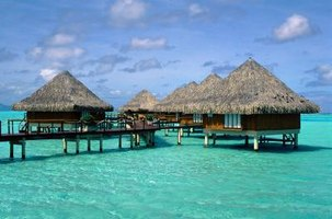 Cozy up with your love in Bora Bora's romantic over-the-water bungalows.