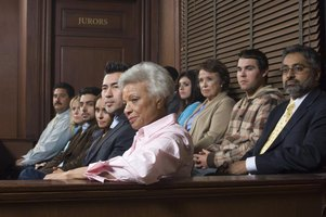 Members of a jury in a courtroom.