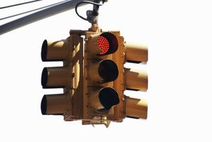 Red light carries more power than similarly visible green light.