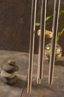 Copper pipe wind chimes produce a robust melodic sound.