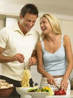 Cooking together can be a pleasurable activity for a couple.