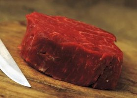 Purchase a thick cut with a lot of fat marbling throughout the flesh.