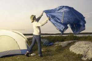 A standard blue tarp can provide additional shelter while camping.