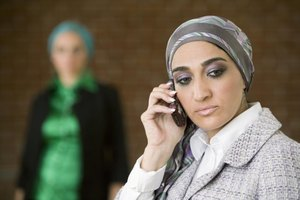 An upset woman on the phone.