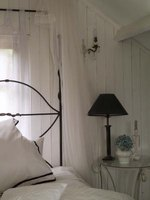 Instead of buying the real thing, create a faux wrought-iron headboard easily and inexpensively.
