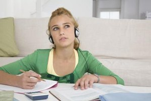 Teens often do homework while listening to music.