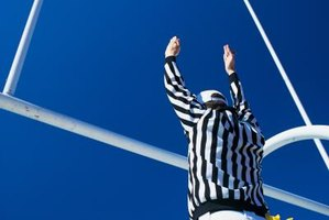 Football referee indicating a field goal.