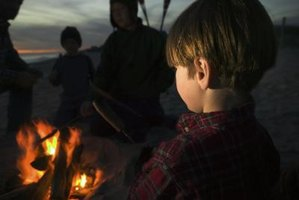 Relax after a fun day of camping by telling stories around a campfire.